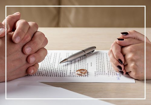 Wife And Husband Signing Divorce Documents