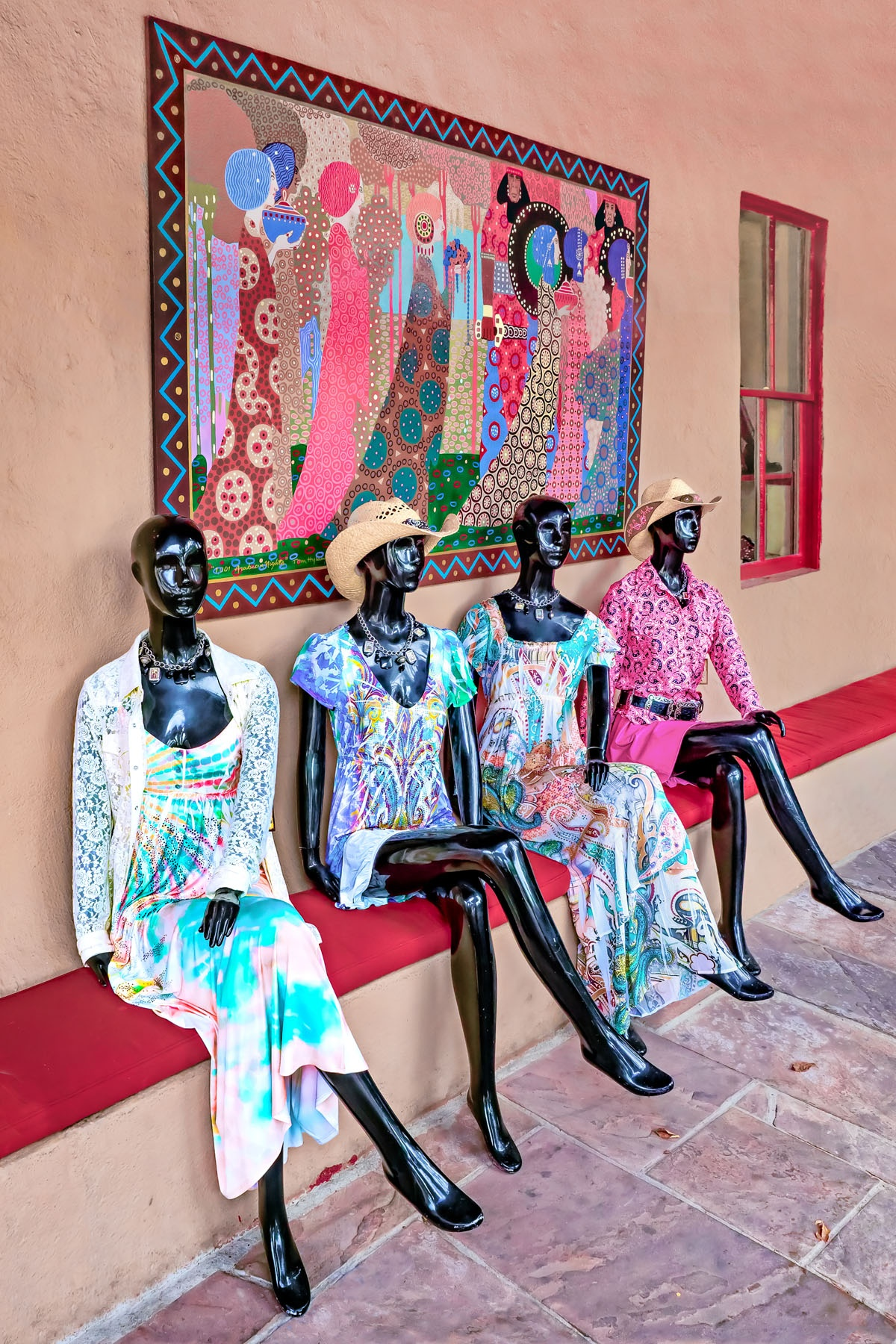 CLASSY LADIES - My wife and I stopped at a streetside cafe in Santa Fe. Next door was a ladies apparel/jewelry store. These ladies were adorned with inventory from that shop. They graciously posed for this photo.