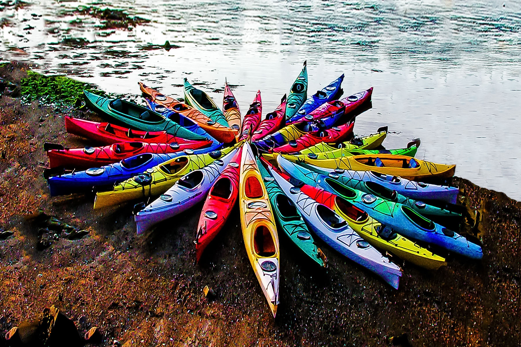 KAYAKS - People often ask if I set this up. I wish I was that creative, and could answer yes. But, this is just the way they were that morning at the kayak rental place in Rockport, Massachusetts.
