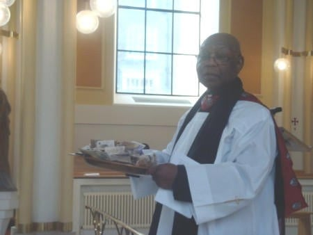 Rev.Lionel Crompton-Thomas blessing the special collection for the scholarship fund