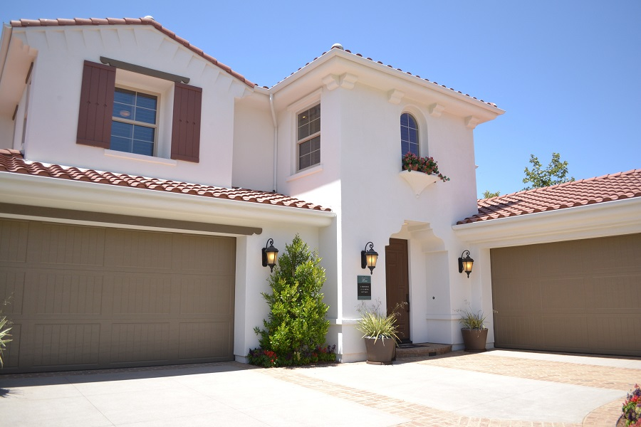 House with Two Brown Garage Doors