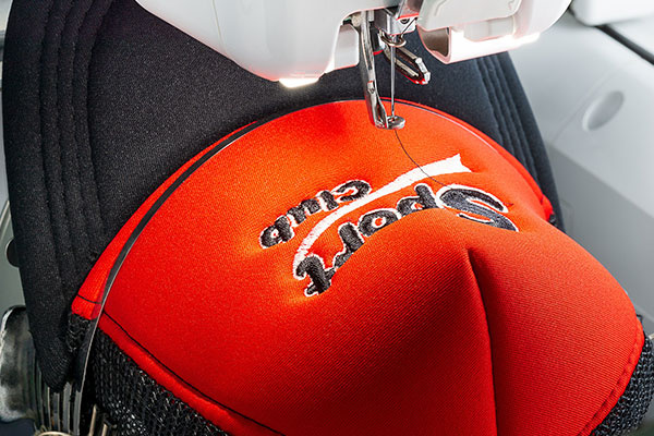 Red Cap on The Hoop of Embroidery Machine