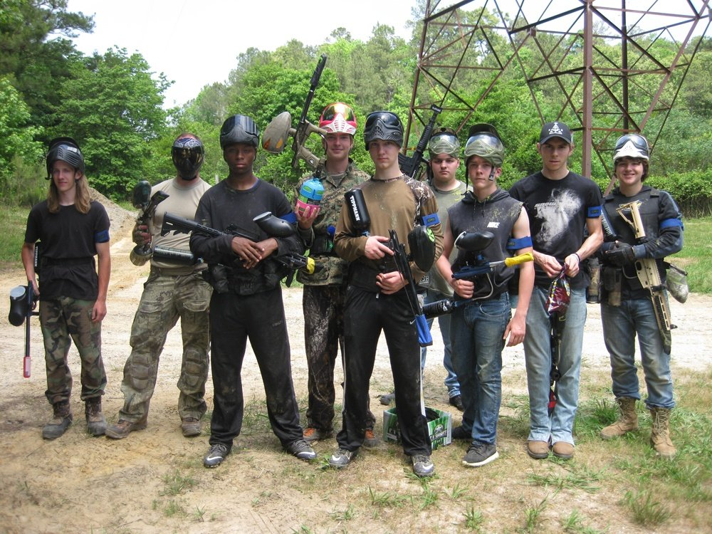 Paintball players with their fellow teammates