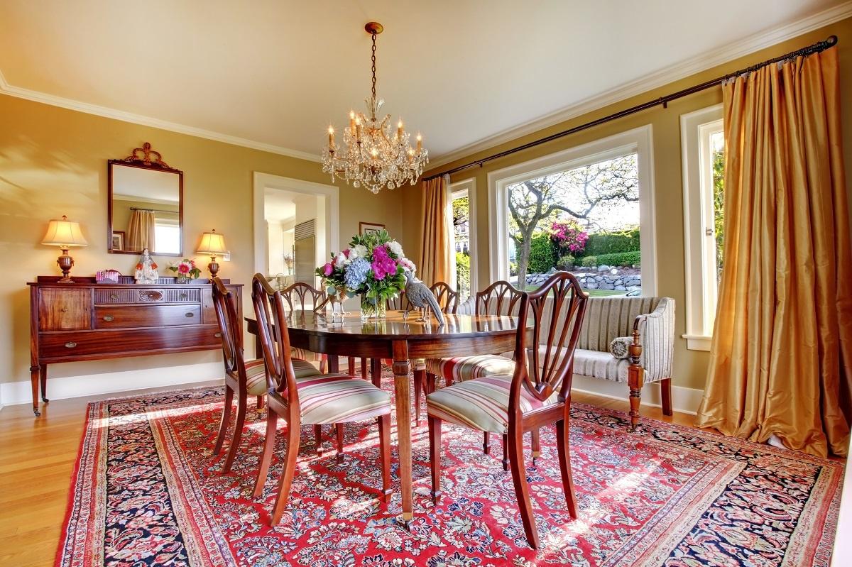 Area rug on hardwood floor in dining room