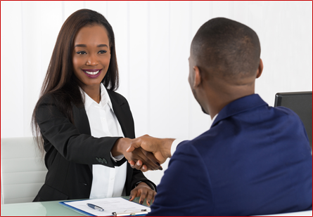 Smiling Candidate Shaking Hands with Interviewer