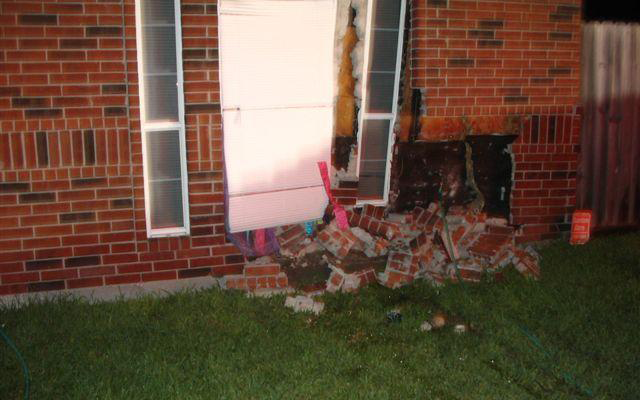 Damaged exterior of brick home