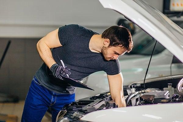 Mechanic Examining