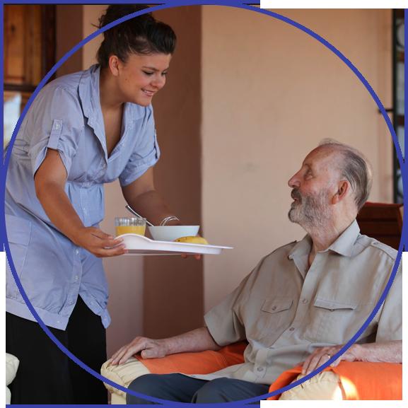 nurse or helper in residential home giving food