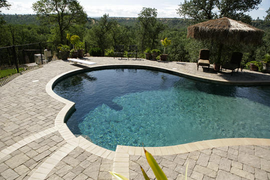 Pavestone light colored for a beautiful look around the pool