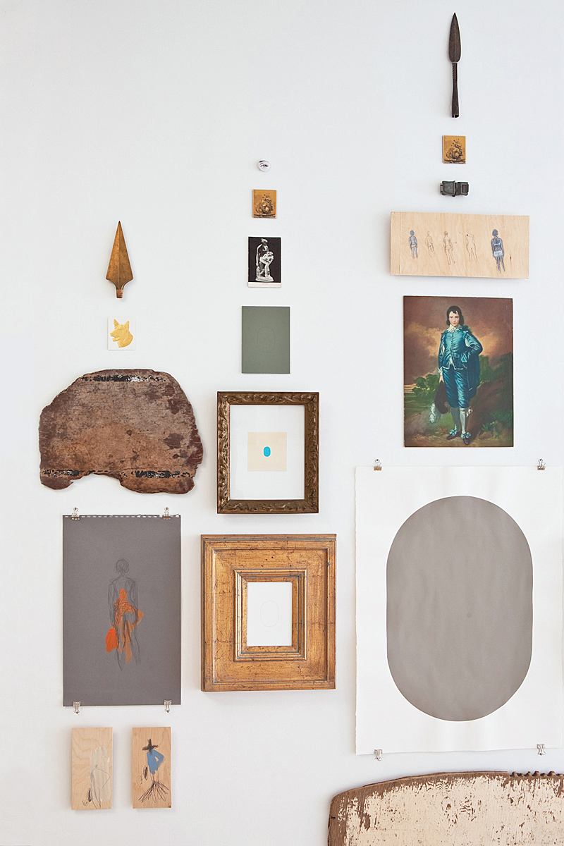 The Blue Boy, a grey painted oval and other art and objects arranged on a wall.