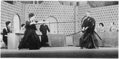 "NHK television program ""That's Me."" With daughter Kyoko (jukendo 4th dan) using the spear.  Later she was promoted to 5th dan by the All Japan Jukendo Federation."
