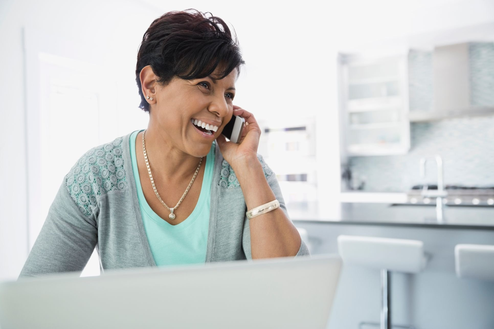 Middle-aged woman using mobile phone at home