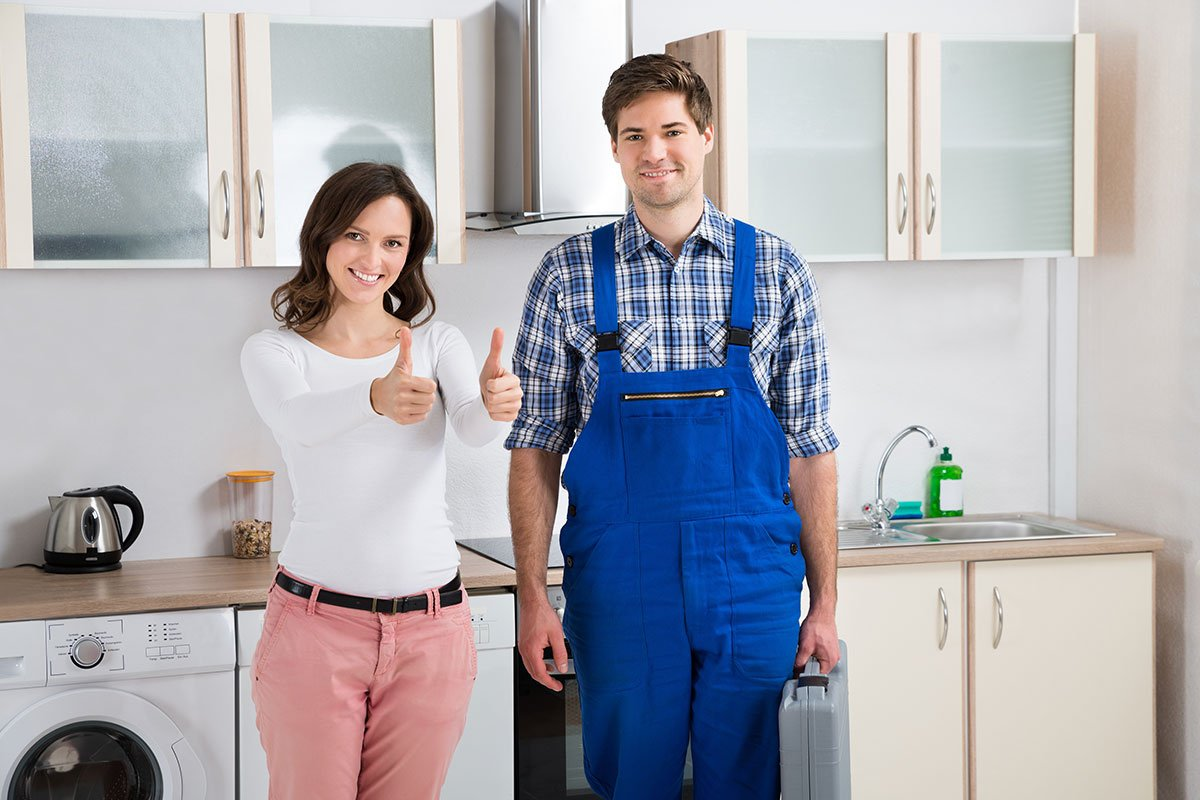 Woman With Repairman Showing Thumbs Up Sign