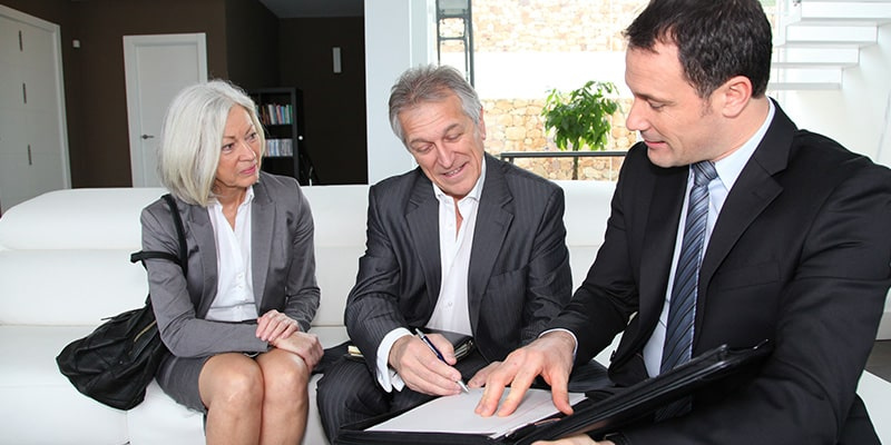 Senior Couple Signing Financial Contract for Property Purchase