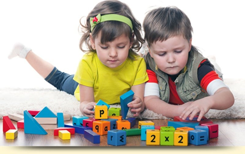 Kids Playing with Alphabet Blocks
