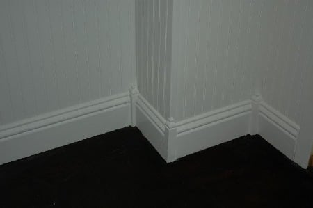 Base molding feature corner blocks with finials.