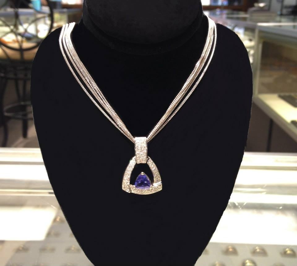 Trillion-cut tanzanite pendant in white gold on white gold multi-strand chain