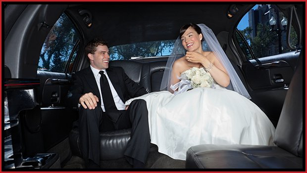 Newly-Wed Couple In Limousine