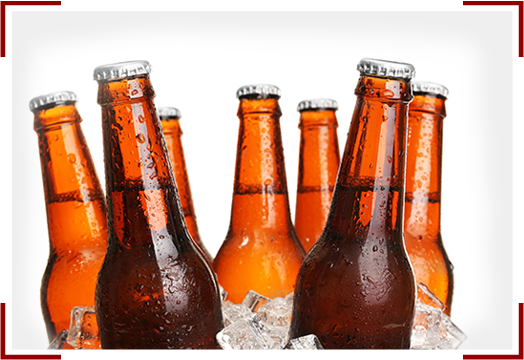 Glass Bottles Of Beer In Ice Cubes