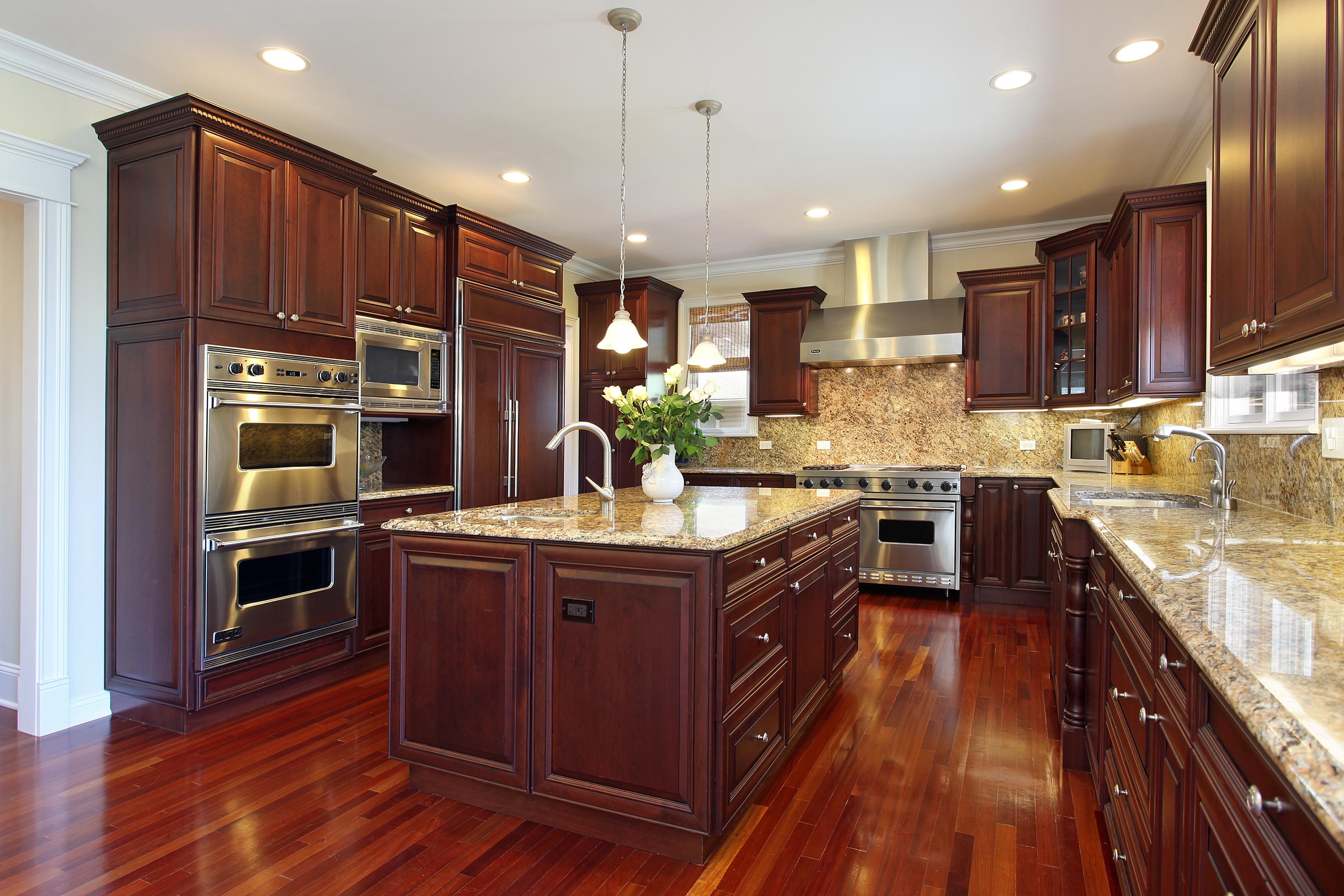 Kitchen Remodel with dark walnut cabinets and luxury granite countertops