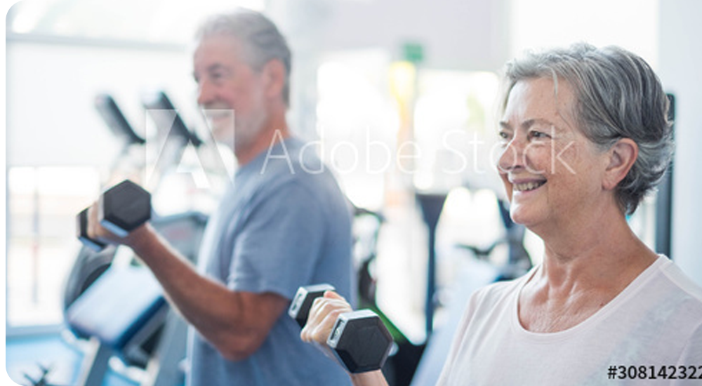Two Seniors Training Together at the Gym