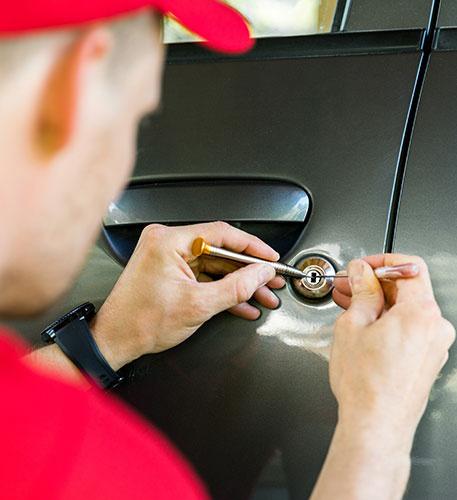 Locksmith Opening Car Door With Lockpicker