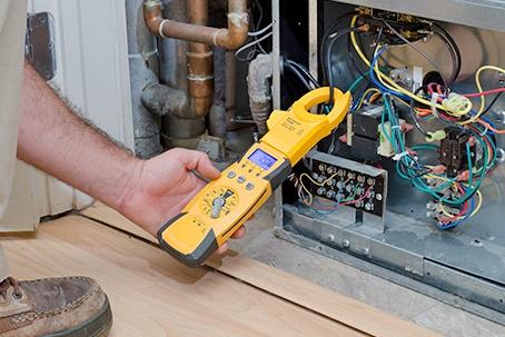 Technician Checking Compressor