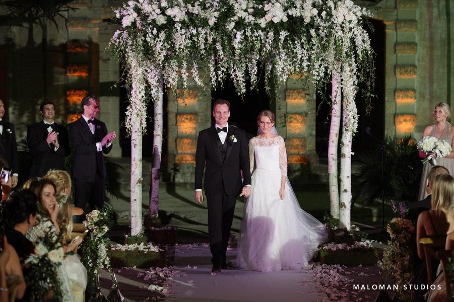 Lovely couple under their ceremony Chuppah