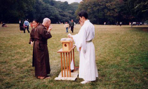 "Following the exhibition, participants are served ""blessed"" sake that has been donated to the Meiji Shrine."