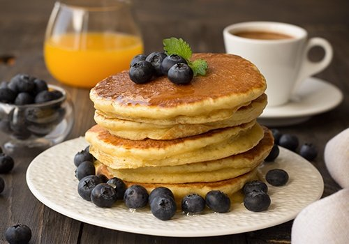 Pancakes with fresh blueberries and honey
