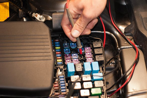 Technicain Checking Car Fuse