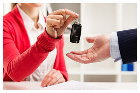 Car Agent Giving Key to Male Customer for Test Drive