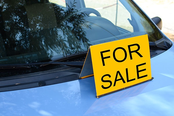 """FOR SALE"" Sign On Car"