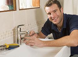 Plumber Repairing Faucet