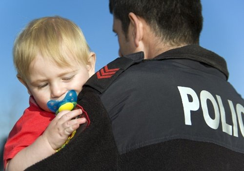 Child Abuse- Police Officer Holds Baby