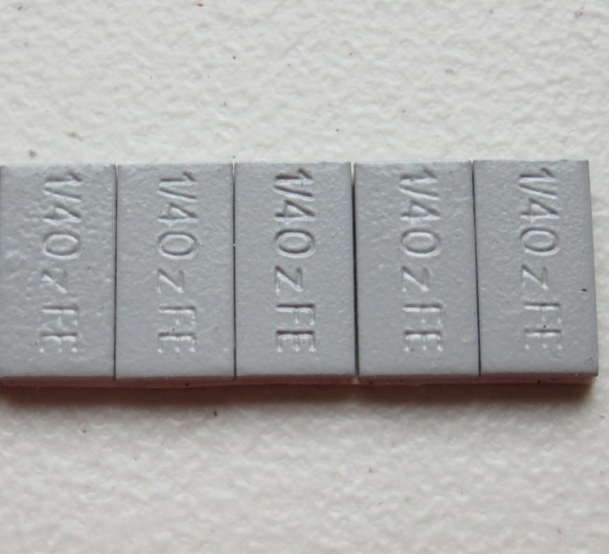 """Contrapeso de 1/4 oz en fe coated gris en ancho de 1"""""""