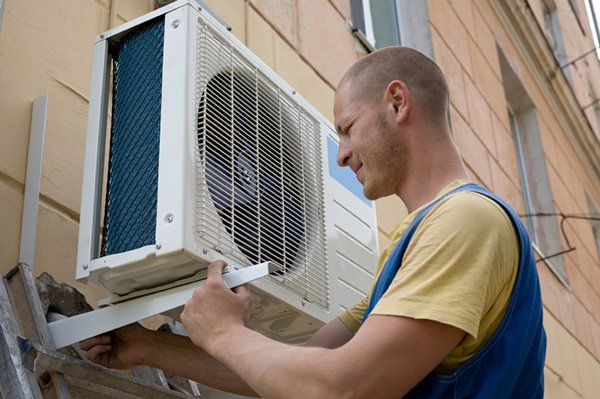 Installer setting a new air conditioner