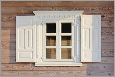 Wooden Window with Beautiful White Shutters