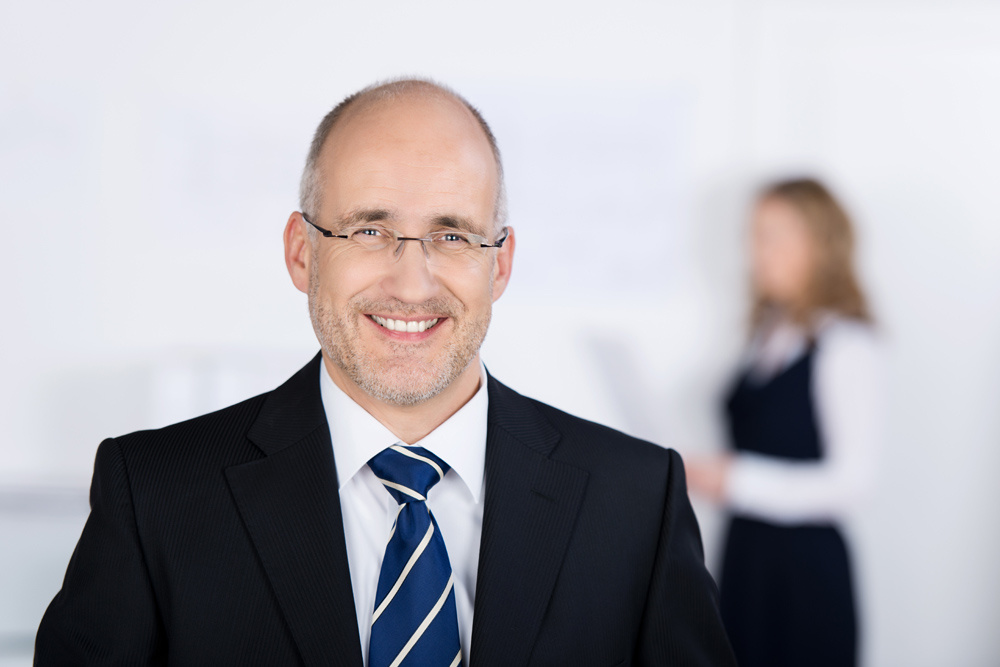 Smiling successful businessman