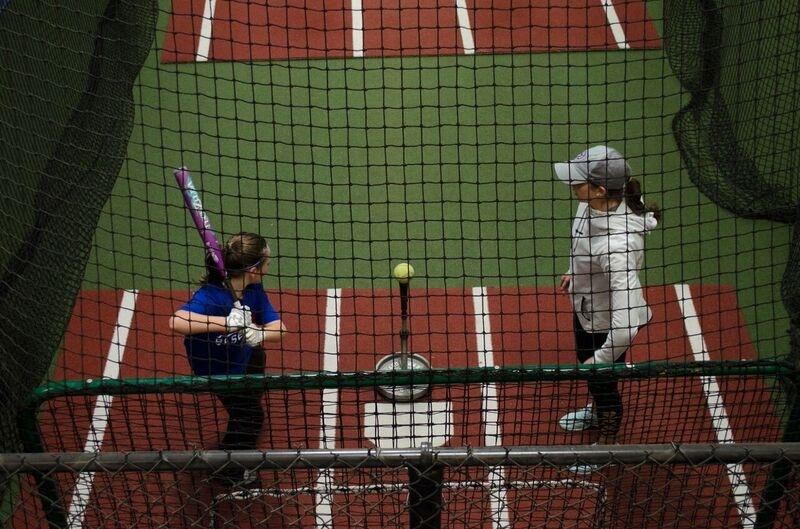 Girl Playing Softball Top View