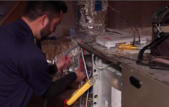 Service man testing a furnace