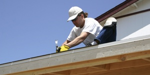 Carpenter Repairing Roof