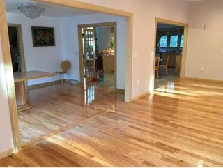 Photo shows transition of addition with existing rooms flawlessly flowing into open floor plan.