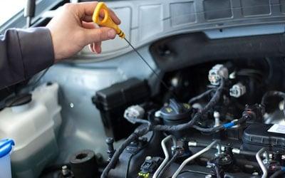 Mechanics Working On a Car Engine