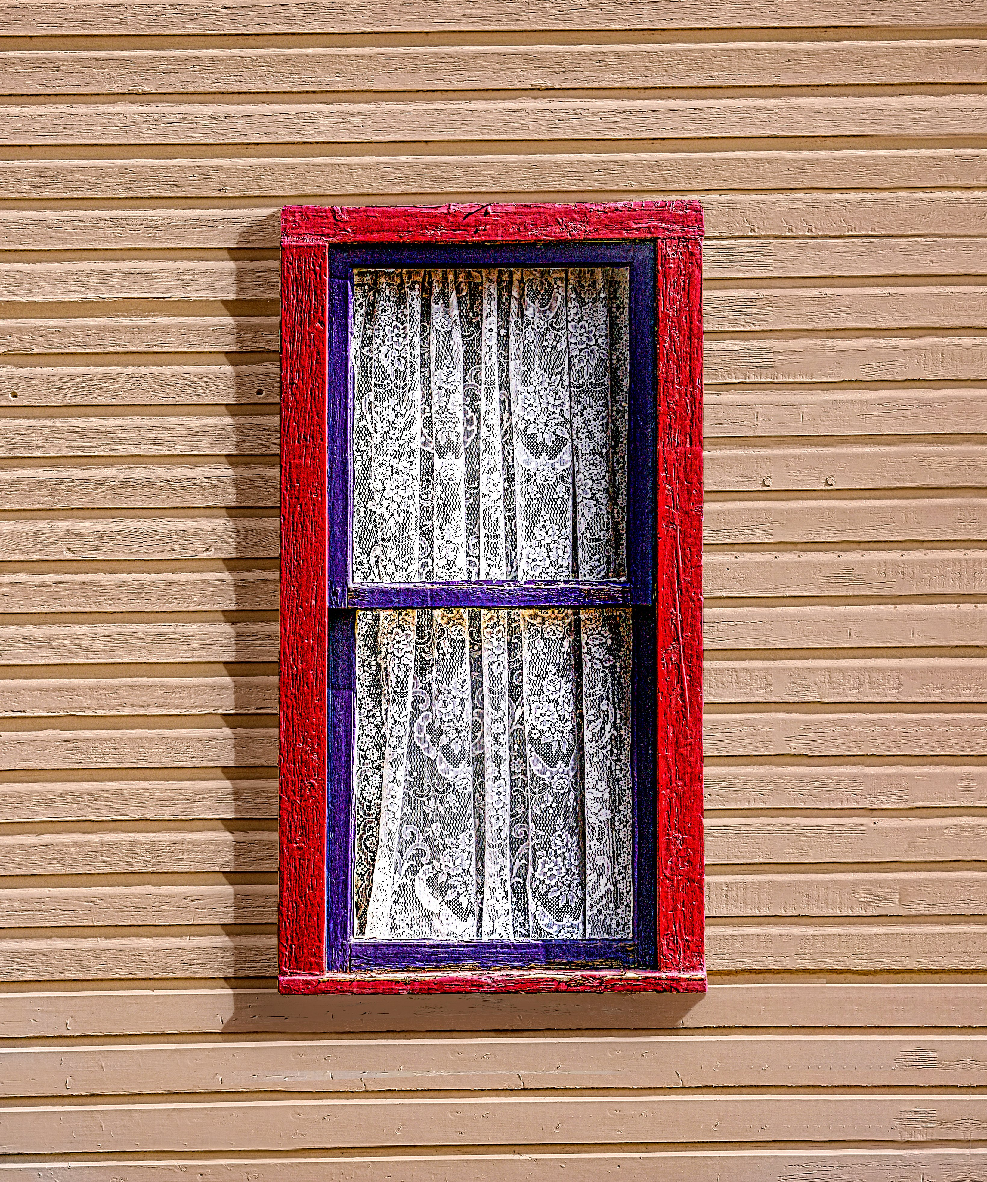 LACEY - Windows are often great photo subjects. Though simple, this one had it all... color, texture in the old siding and trim and of course, the lace.