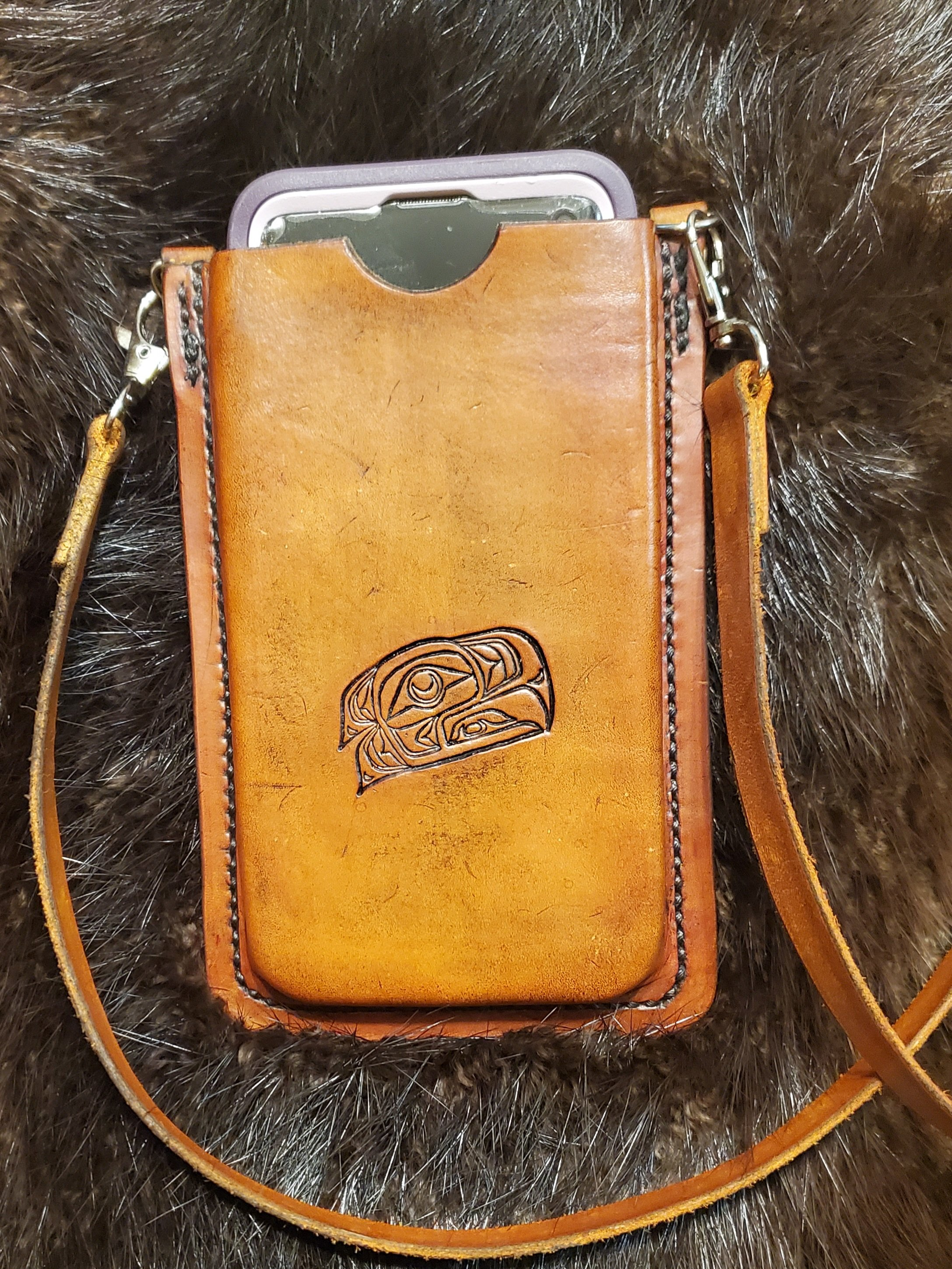 (Front)  Leather cell phone case with strap, hand tooled and hand stitched,  $85.00