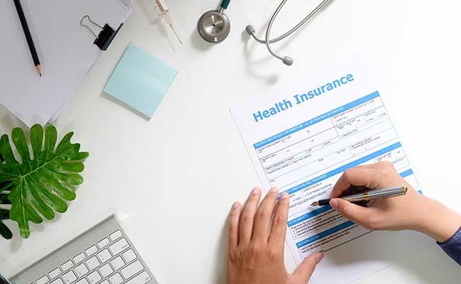 Man Sign And Reading Health Insurance