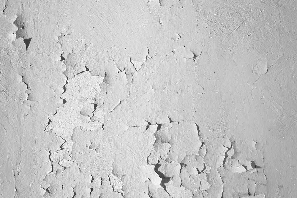 Paint peeling off the side of a house