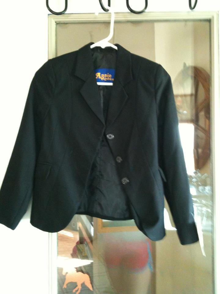 Annie Rider English Hunt coat (black). Brand new, tag still on it. Mint condition. asking $40. Child's size 12.
