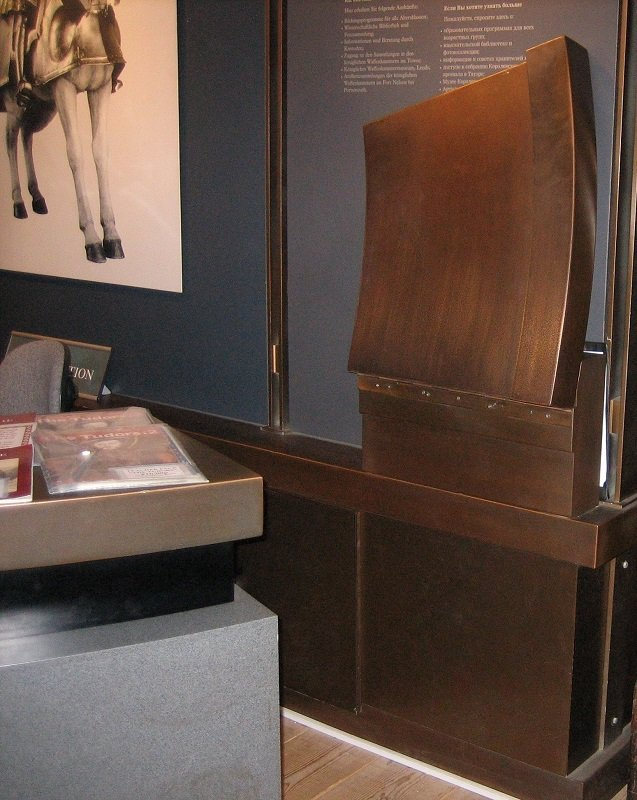 Bronze veneer finish coating applied on MDF. Bronze & pewter on the Tower of London reception desk.